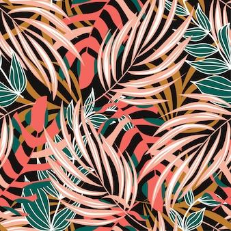 カラフルな熱帯の葉と黒の背景上の植物で夏の抽象的なシームレスパターン