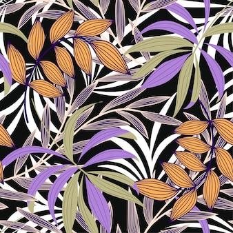 カラフルな熱帯の葉と黒い背景に植物の抽象的なシームレスパターンをトレンド