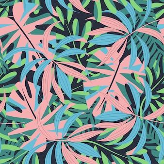 Яркий абстрактный бесшовные модели с разноцветными тропическими листьями и растениями на синем
