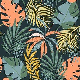 Летний абстрактный бесшовные модели с разноцветными тропическими листьями и растениями на синем