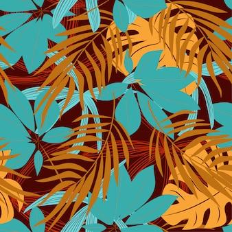 カラフルな熱帯の葉と赤い背景の植物の元の抽象的なシームレスパターン