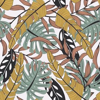 カラフルな熱帯の葉と白い背景の植物と抽象的なシームレスパターン