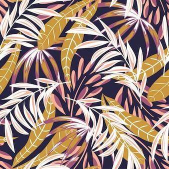 カラフルな熱帯の葉と花を持つトレンディな抽象的なシームレスパターン
