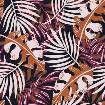カラフルな熱帯の葉と黒い背景に植物の元の抽象的なシームレスパターン