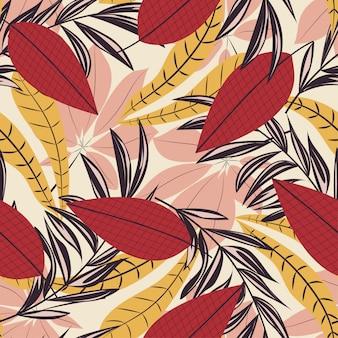 カラフルな熱帯の葉と植物のトレンドのシームレスパターン