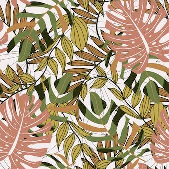 カラフルな熱帯の葉と植物の抽象的なシームレスパターン
