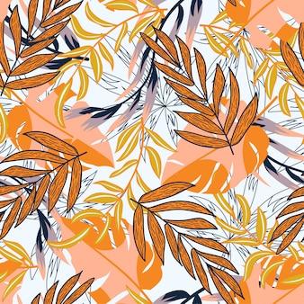 カラフルな熱帯の葉と植物の抽象的なトレンドのシームレスパターン