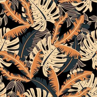 カラフルな熱帯の葉と黒い背景に植物と抽象的なシームレスパターン