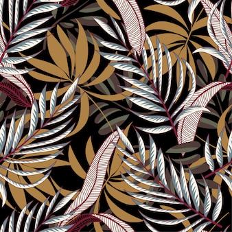 カラフルな熱帯の葉と黒い背景に植物のトレンドの抽象的なシームレスパターン