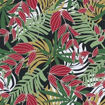 カラフルな熱帯の葉と灰色の背景に植物の抽象的なシームレスパターン