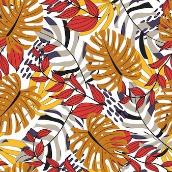 カラフルな植物と赤と黄色の葉のトロピカルスタイルのシームレスパターン