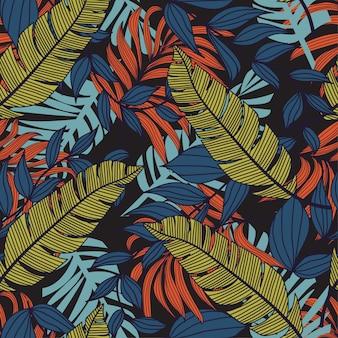 ブルーの色調でトロピカルスタイルのシームレスパターン。エキゾチックな壁紙、ヤシの葉
