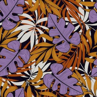 紫とオレンジの植物と葉を持つ熱帯のシームレスパターン