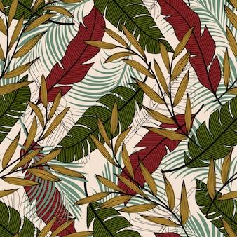 赤と緑のカラフルな植物と葉を持つ熱帯のシームレスパターン