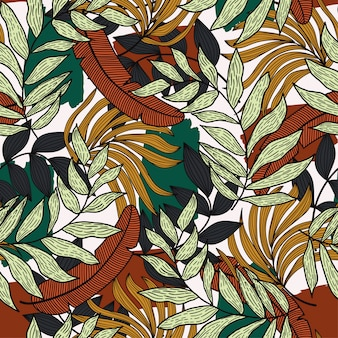 カラフルな葉と明るい背景に植物と熱帯のシームレスパターン