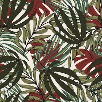 葉と白い背景の植物と熱帯のシームレスパターン