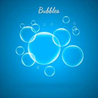 青い背景に水のアクアの泡。