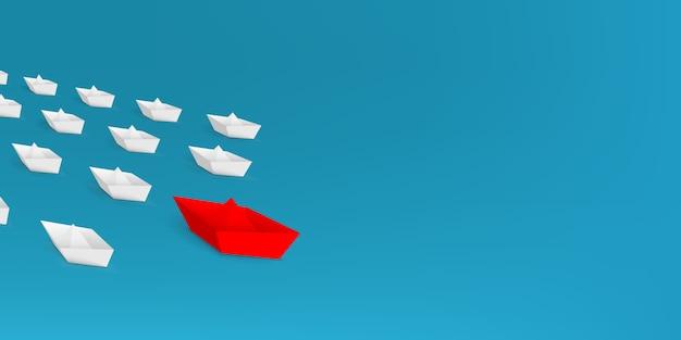 Лидерство красный бумажный кораблик, ведущий среди кораблей.