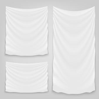 Висит пустая белая ткань ткань текстильная баннер.