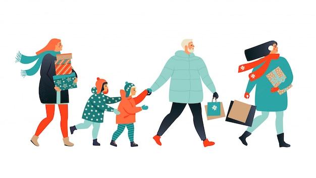 歩いてプレゼントボックスを運ぶ人々とメリークリスマスバナー。
