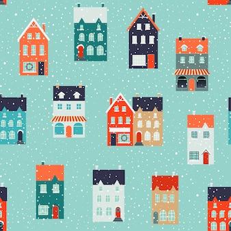 クリスマスとクリスマスの生地と装飾のための冬の家。シームレスパターン。