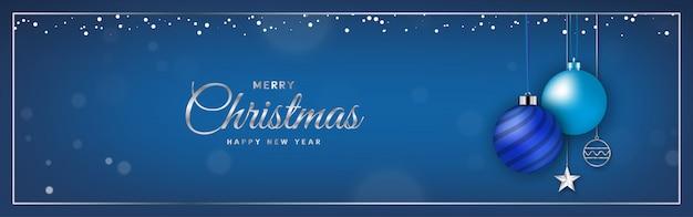 Синяя рождественская открытка с елочным шаром
