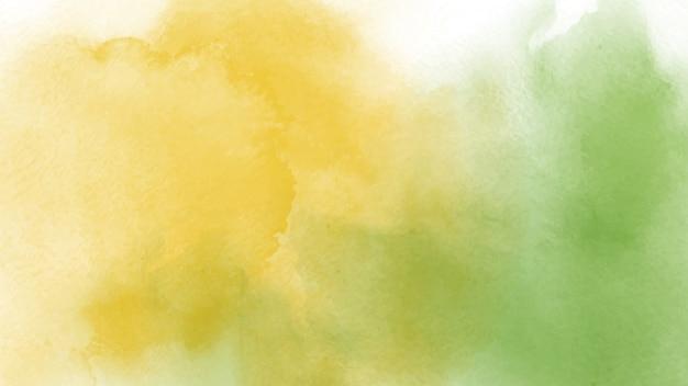 抽象的な手描きの背景の黄色と緑の水彩画。