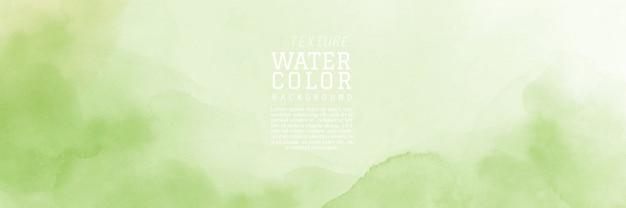 抽象的な手描きの淡い緑の自然の水彩画