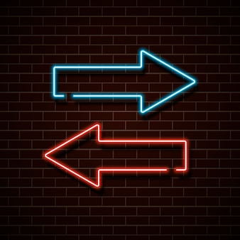 レンガの壁に赤と青のネオンの矢印。