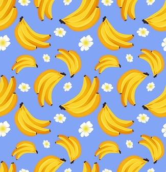 バナナとのシームレスなパターン。トロピカルフルーツ。布、紙の装飾品のデザインのコンセプト。