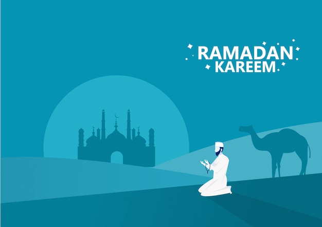 Рамадан карим, человек молится и читает аль-коран