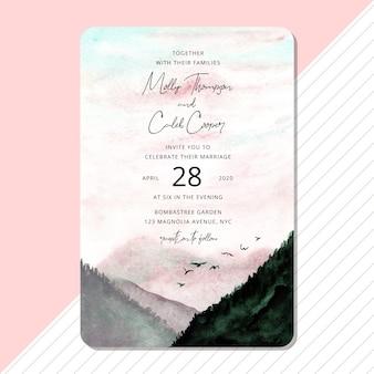 美しい風景の水彩画の背景を持つ結婚式の招待状