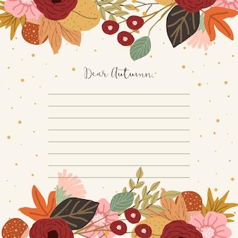 秋の花の背景とノート紙