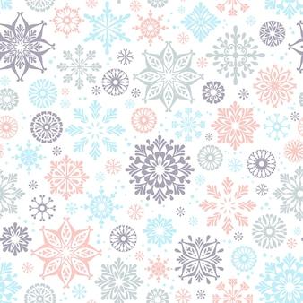 冬のシームレスなパターンと雪片。