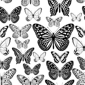 熱帯の蝶黒と白のシームレスパターン。