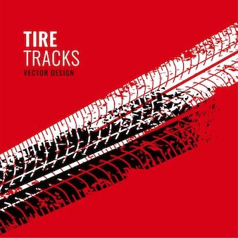 赤い背景とタイヤのトラックマーク