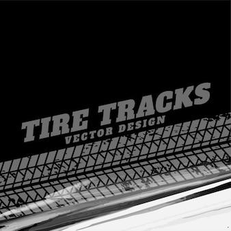 タイヤのトラックマークと黒のグランジの背景