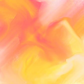 抽象的な手は黄色の水彩テクスチャの背景を描いた