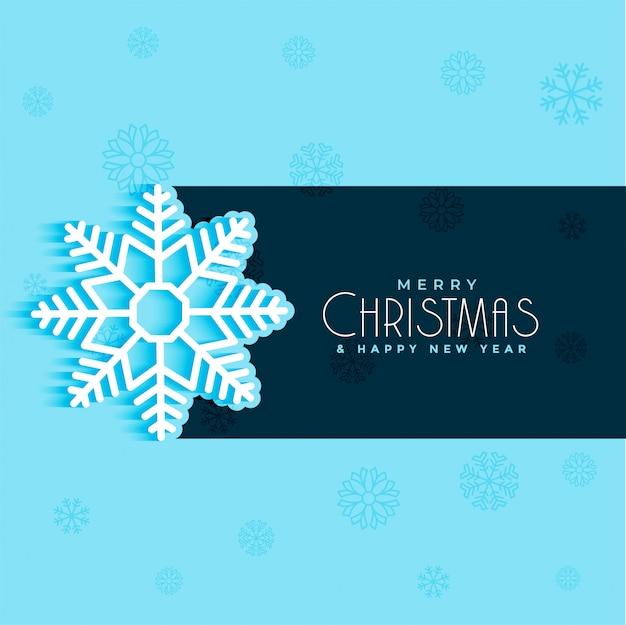 青の背景にクリスマスの雪片のデザイン