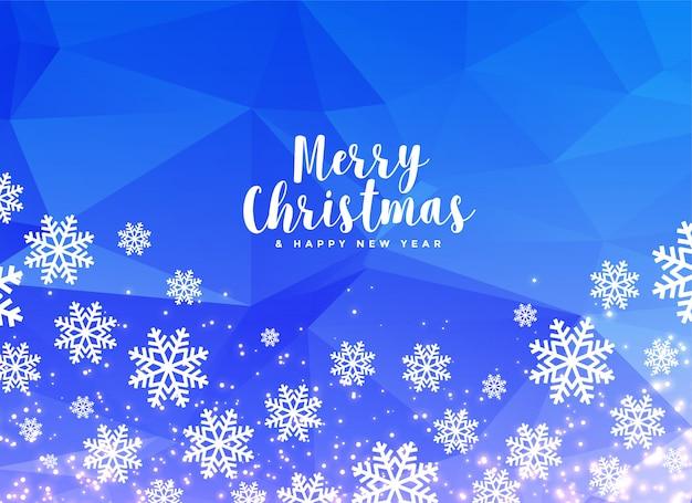 青い背景に白い冬のクリスマスの雪片