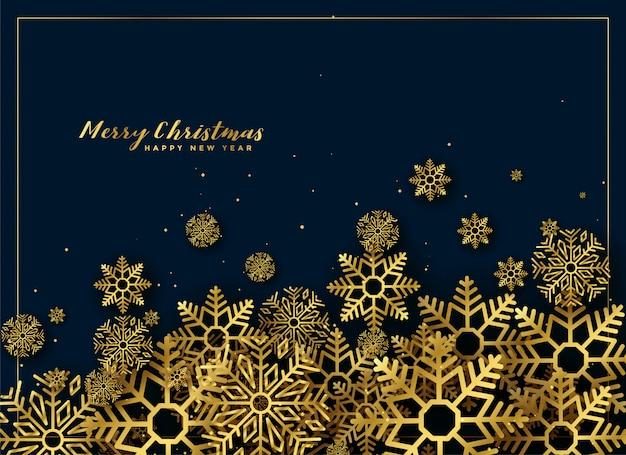 ゴールデンクリスマスの雪片の背景の装飾