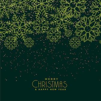 美しいクリスマスグリーンの雪片の背景