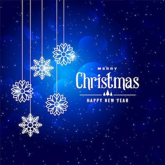 素敵な青いクリスマスの冬のスタイルの雪片の背景