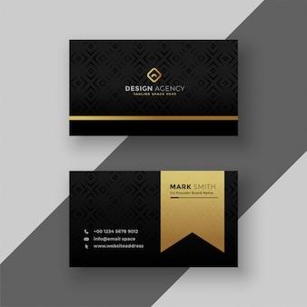 Стильный черный и золотой дизайн визитной карточки