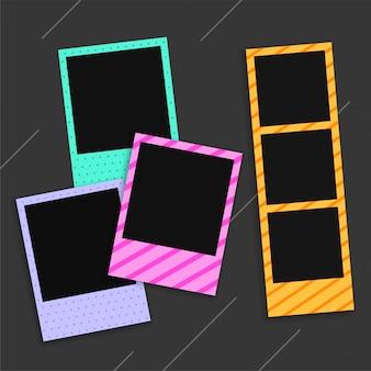 Пустые рамки для фотографий на черном