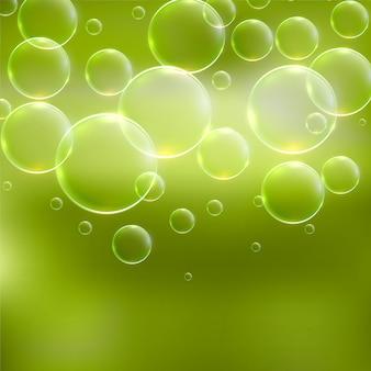 泡と抽象的な緑の背景