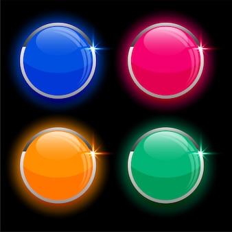Круглые кружочки блестящих стеклянных кнопок в четырех цветах