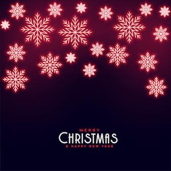 Красивые красные неоновые падающие снежинки новогодний фон