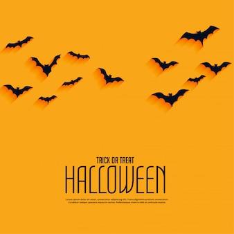 Желтый счастливый фон хэллоуин с летающими летучими мышами