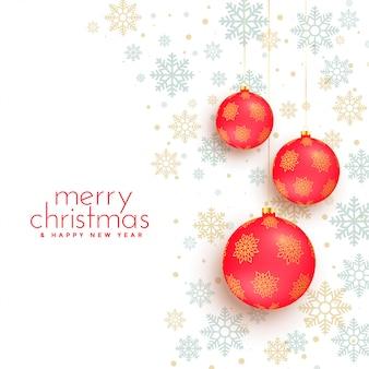 赤いボールの装飾とメリークリスマスホワイトバックグラウンド